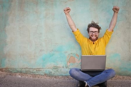 happy man with laptop computer