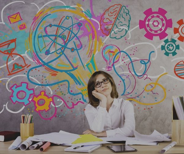 woman thinking with gears lightbulbs brains and molecules floating above her head