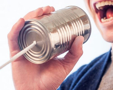 Contact Us at DRC Technologies Person talking through a can on a string