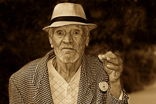 Funny picture of elderly man holding pocket watch