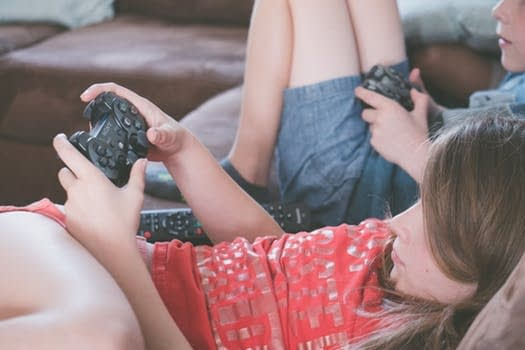 Kids playing video games. Gamers