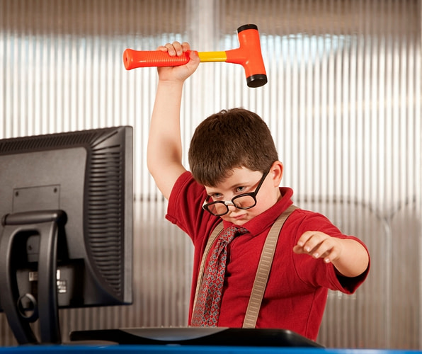 kid about to hit a computer with a hammer