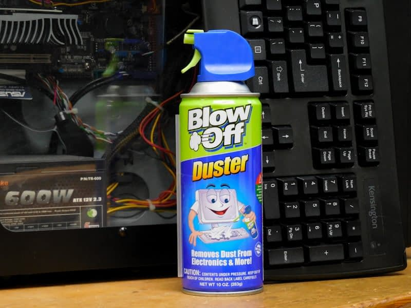 can of blow off duster with computer and keyboard